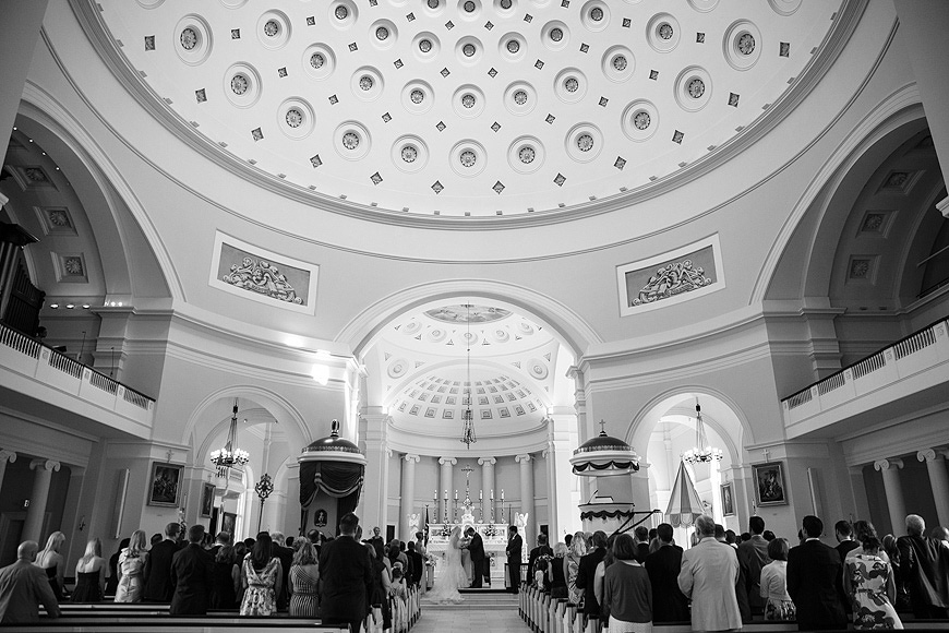 Wedding ceremony captured in black and white with a wide angle lens at the Baltimore Basilica