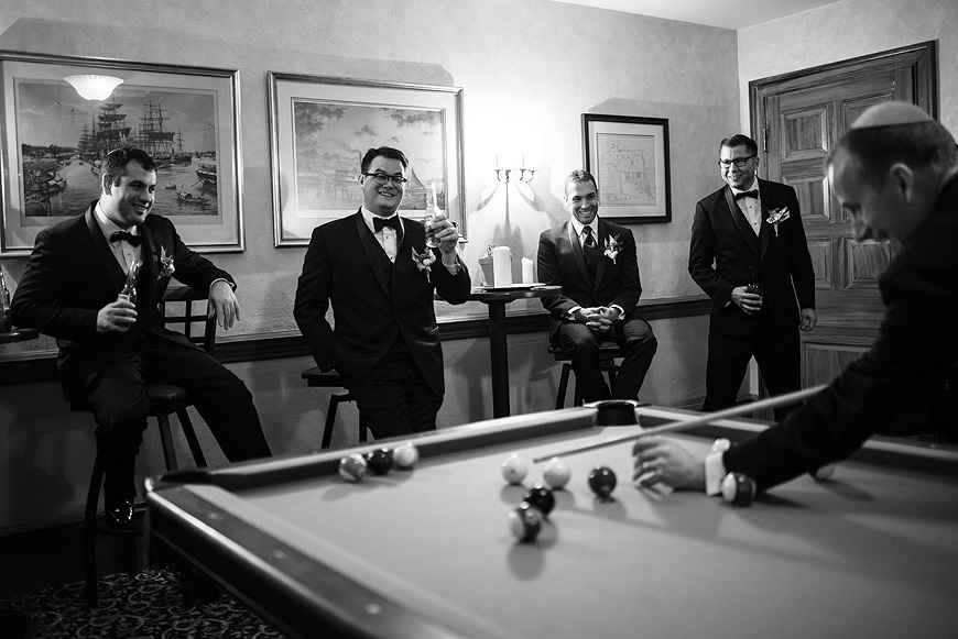Groom and groosmen play pool before a wedding at the Engineers Club in Baltimore