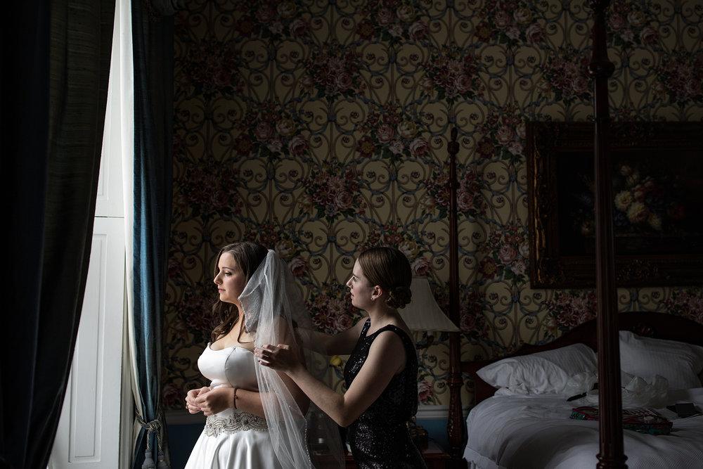 Bride in her veil in window light at Antrim 1844 in Maryland
