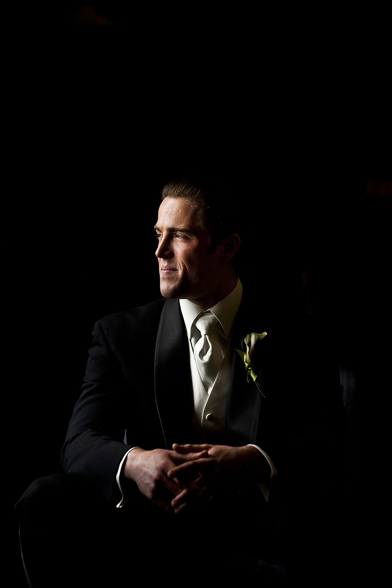 Groom lit by window light before wedding at the Grand Venue in Baltimore