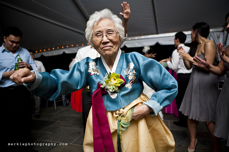 Older woman dancing at wedding reception at Strong Mansion