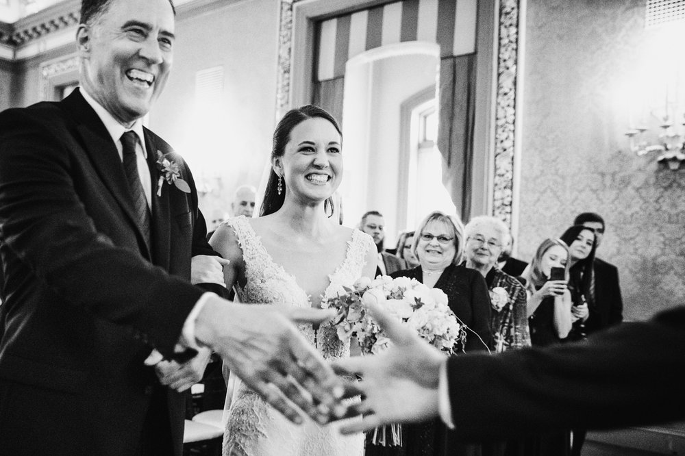 Bride and father of the bride smiling during wedding ceremony at Belvedere Hotel in Baltimore