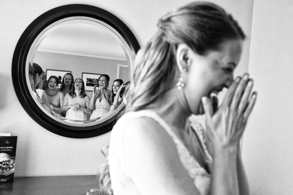 Bride laughing while getting ready at the Belvedere Hotel in Baltimore