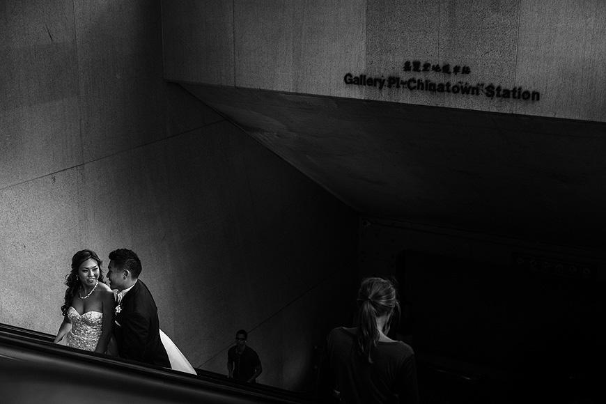 Bride and groom on the Metro escalator in Washington DC