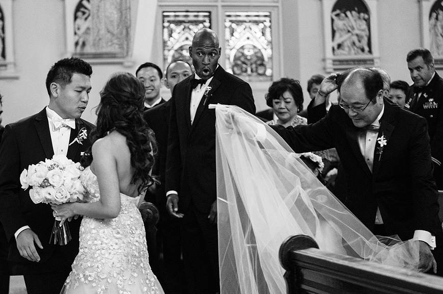 Bride looses her veil as she walks down the aisle