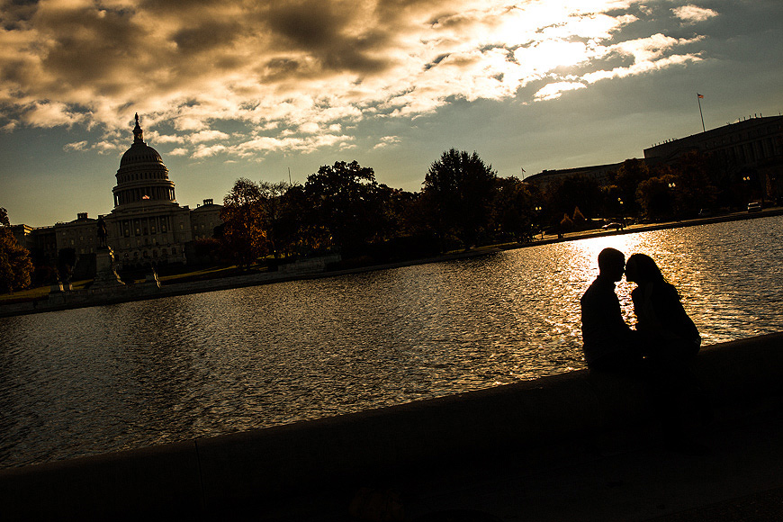 Couple silhouetted in front of the Capital Building in Washington DC