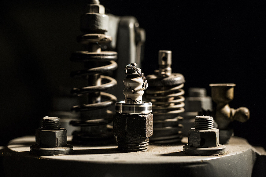 Wedding rings on a spark plug at the Baltimore Museum of Industry