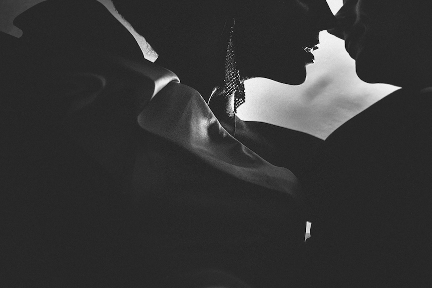 Artistic silhouette of bride and groom kissing