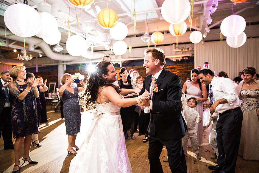 Bride and groom dance at their AVAM wedding