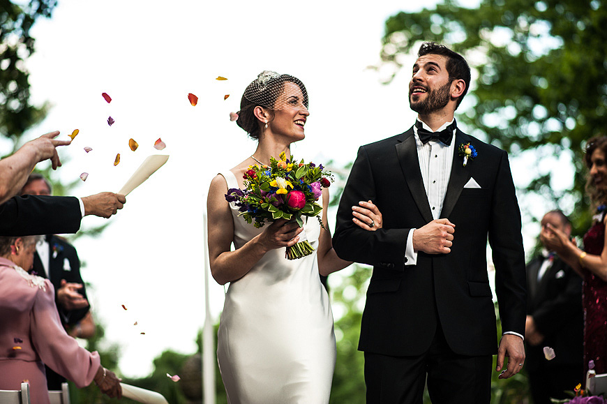 Wedding couple at Gramercy Mansion with guests tossing flower pedals