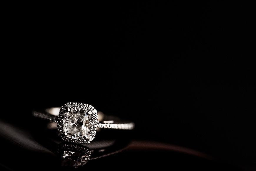 Beautiful engagement ring reflected on black glass