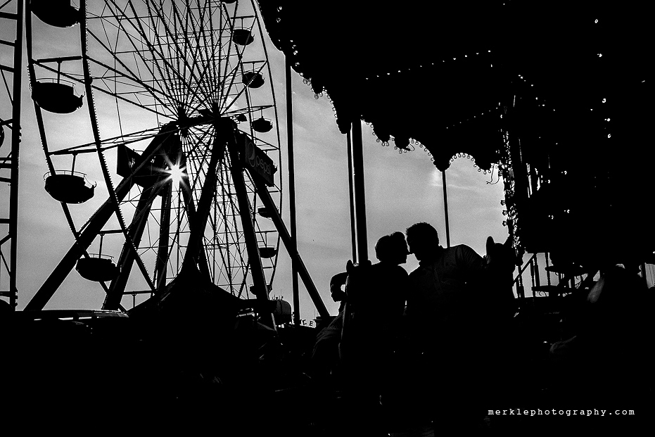 Couple silhouetted against the sky at amusement park in Ocean City Maryland