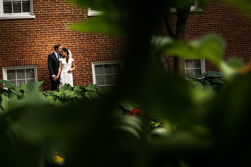 Bride and groom pose outside at Historic Londontown in Annapolis Maryland