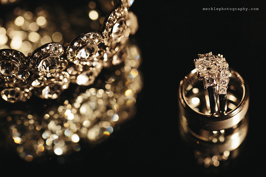 Wedding jewelry sparkling against a black background at Stone Manor
