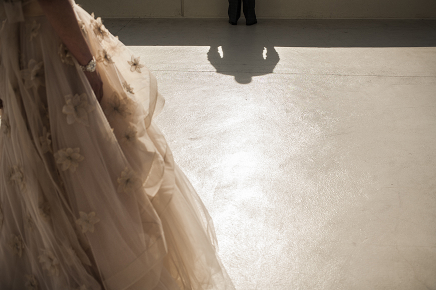Artistic photograph of bride about to meet groom for the first time on their wedding day in Baltimore Maryland