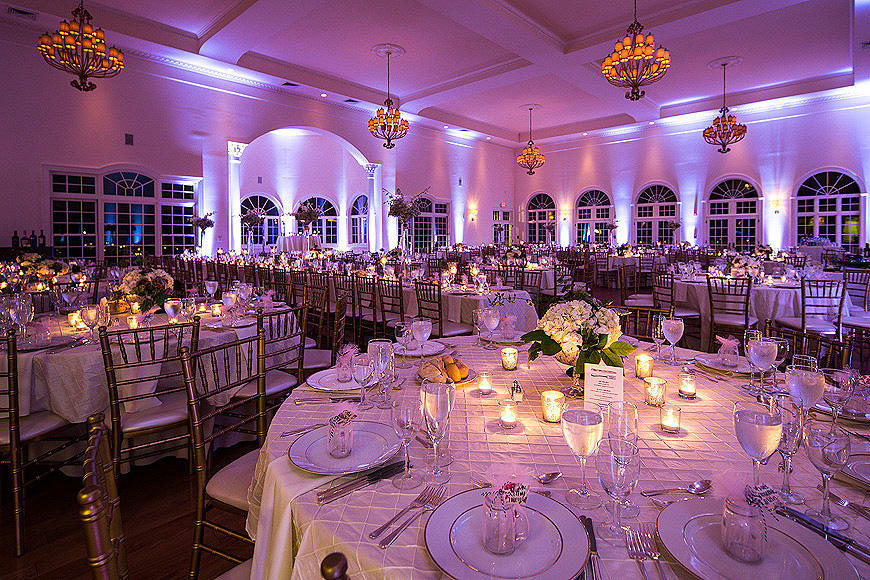 Wedding reception at Morais Vineyards with white floral arrangements