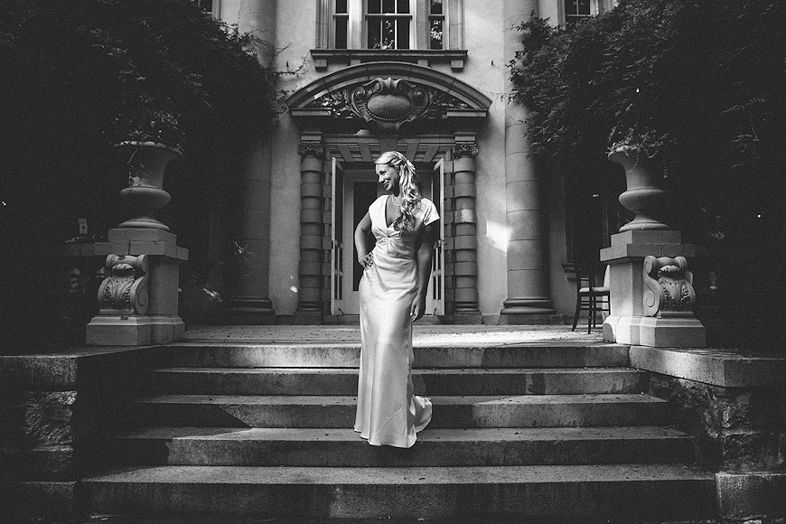 Bride posing on the front steps of the Liriodendron Mansion in Maryland