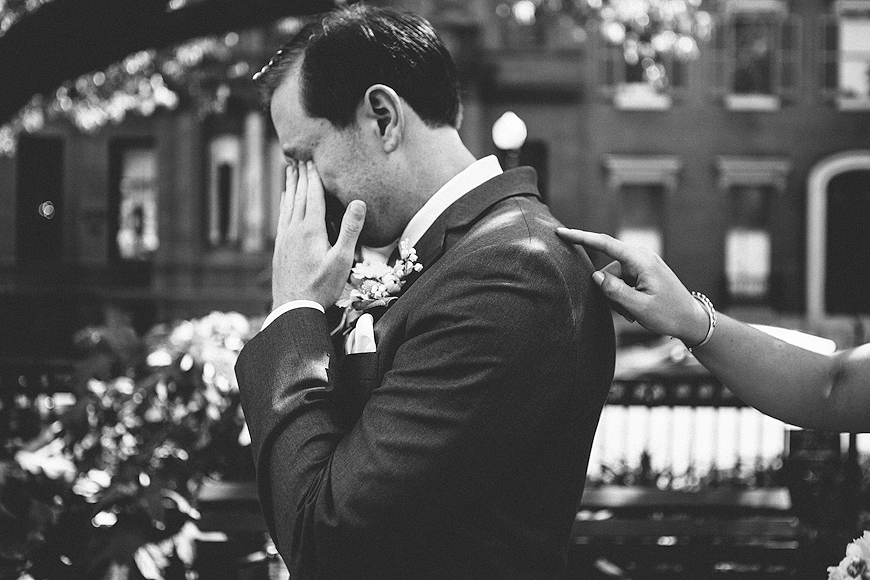 Bride touching back of groom during emotional first look in Baltimore Maryland