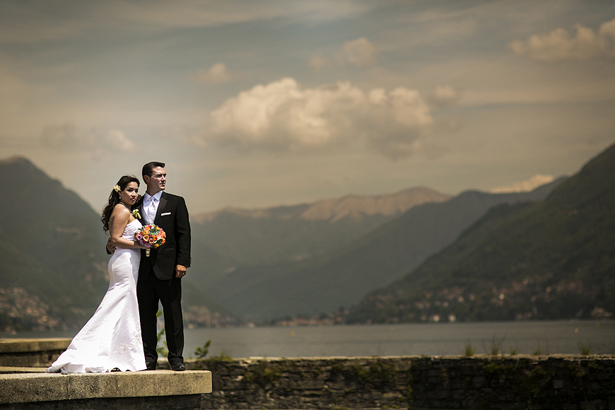 Wedding couple standing along the shore of Lake Como Italy