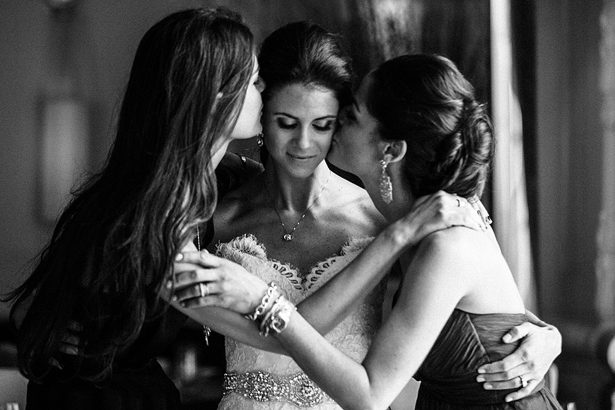 Touching moment between bride and her sisters at the Hyatt at the Bellevue