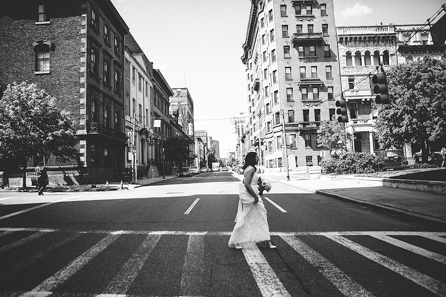 Bride crossing a street in Baltimore Maryland