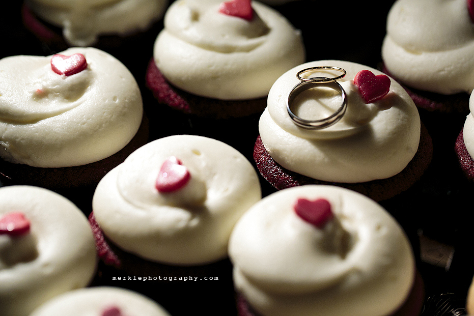 Wedding rings on cupcakes with hearts on wedding day