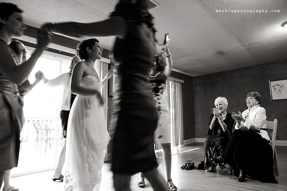 Woman dancing around bride at Linganore Vineyards wedding