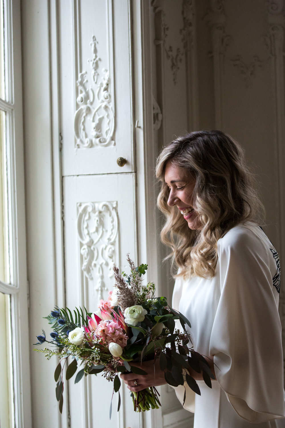 Bridal portrait in window light at the Cylburn Mansion in Baltimore, Maryland