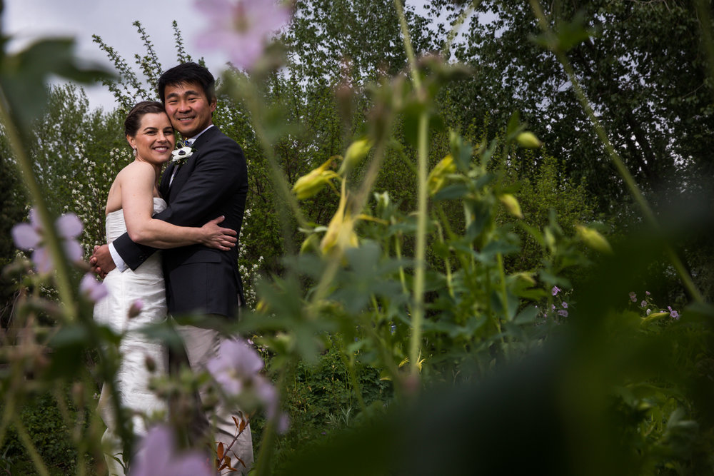 Wedding portrait in front of colorful Colorado wildflowers