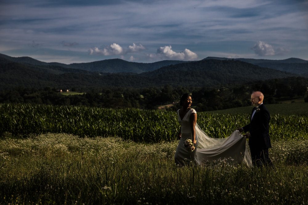 Wedding couple in field, natural light at sunset, Shenandoah Virginia