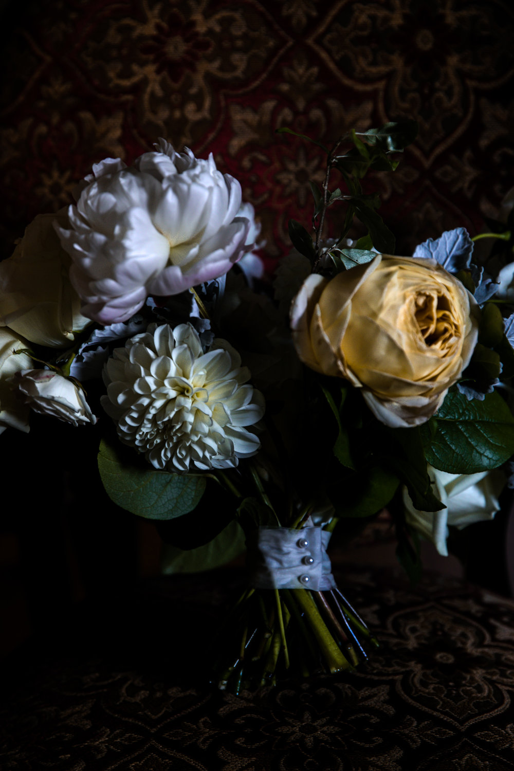 Beautiful wedding day flowers in moody natural light