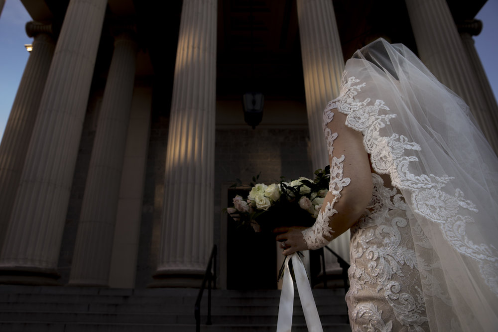 Bride entering the Baltimore Basilica for her wedding
