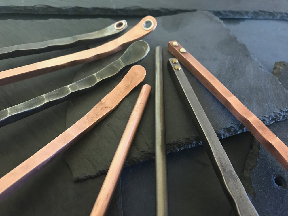 Choose the handle that fits your kitchen. - Each of the beautifully served pieces has a choice of several different handle styles to suit your tastes. The handles come in copper and stainless steel and in flat, round, and square shapes. On the flat handle pieces, there is an option to have a hole in the end of the handle for hainging.