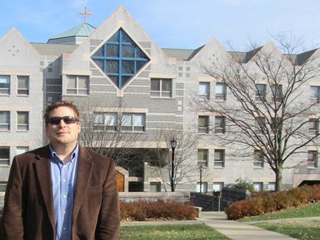 Dr. Mark Scott in front of Villanova University's St. Augustine Center