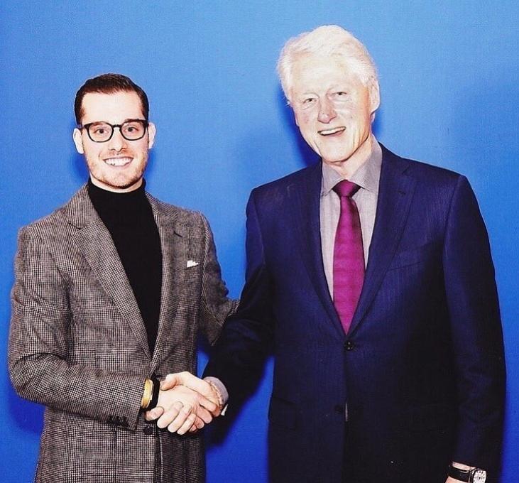 Sam shaking Former President, Bill Clinton's hand after a conversation