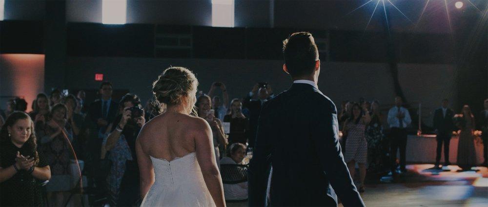 Bride and Groom Walk Into Reception