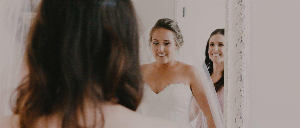 Bride Looks at Beautiful Dress in Mirror