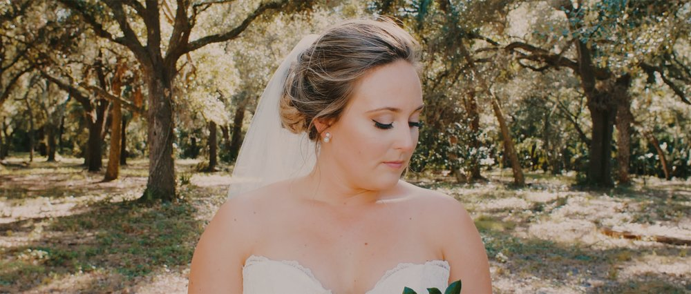 Bride Looks Away in Forest Scene