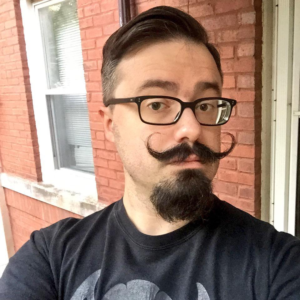 J. Michael Bestul - -J. is an occasional playwright, dramaturg, and tabletop game writer/designer/runner with a background in speech and performance studies. He is also in possession of a very silly mustache. Connect with him on Twitter and Instagram at @dashjperiod.