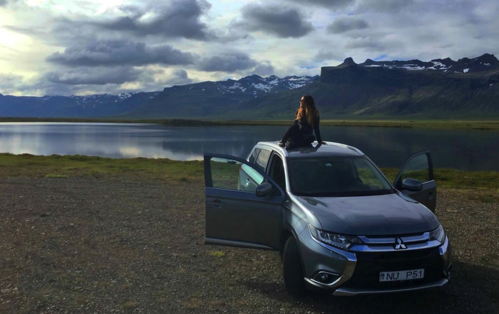 Sitting on our rental car gazing at the beauty of the Ring Road in Iceland on our way to Olfsvik - June 2016