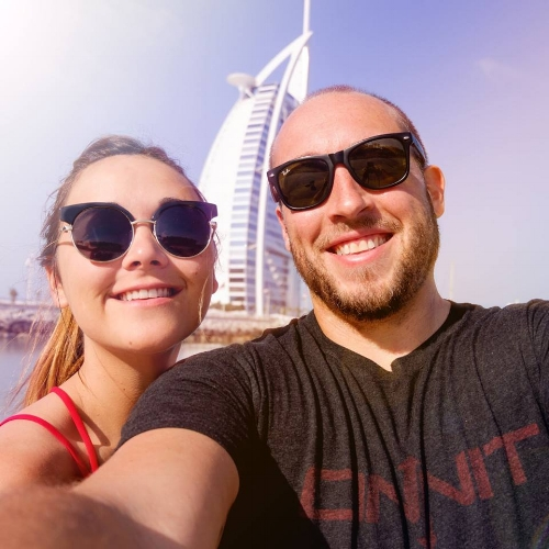 what doesn't suck couple on beach in dubai burj al arab hotel.jpg