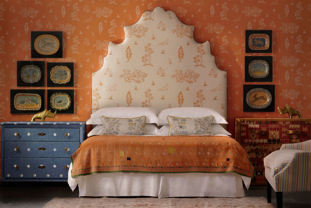 Lucifer-Headboard-upholstered-in-Friendly-Folk-Melon-Orange-Fabric-against-Wychwood-Melon-Orange-Wallpaper-with-chest-of-drawers-in-Over-the-Moon-Denim-Fabric--.jpg