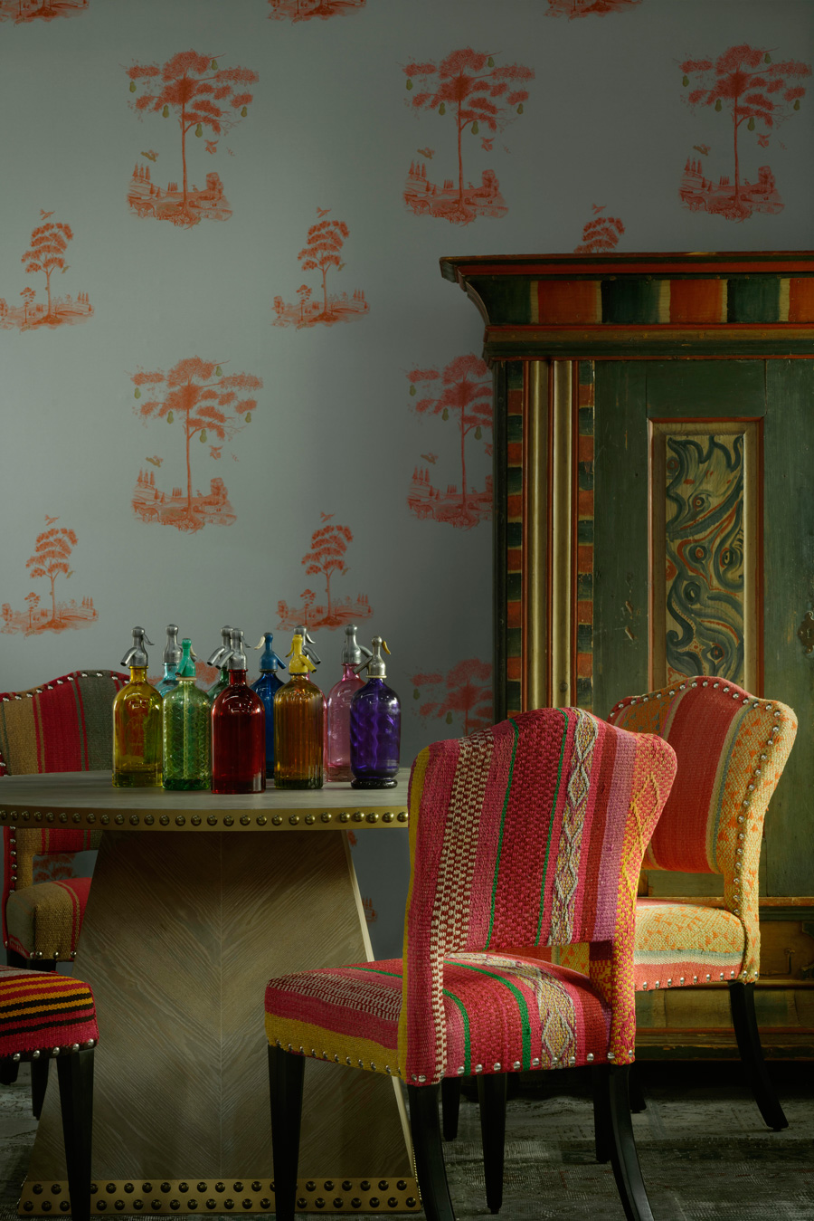 Pear-Tree-Sunset-Orange-Wallpaper-with-Faubourg-Dining-Table-and-Bespoke-Bacall-Chairs-in-Original-Guatlemalan-Textiles.jpg