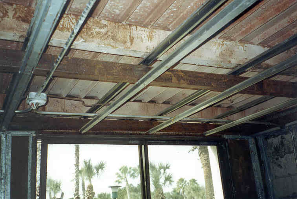 Figure 5:  This is the area below the third floor pan and above the second floor ceiling. This area was found to have significant condensation occurring on the bottom of the pan. This cavity was communicating freely with the wall cavity and the exterior wall, allowing free flow of air throughout these hidden cavities.