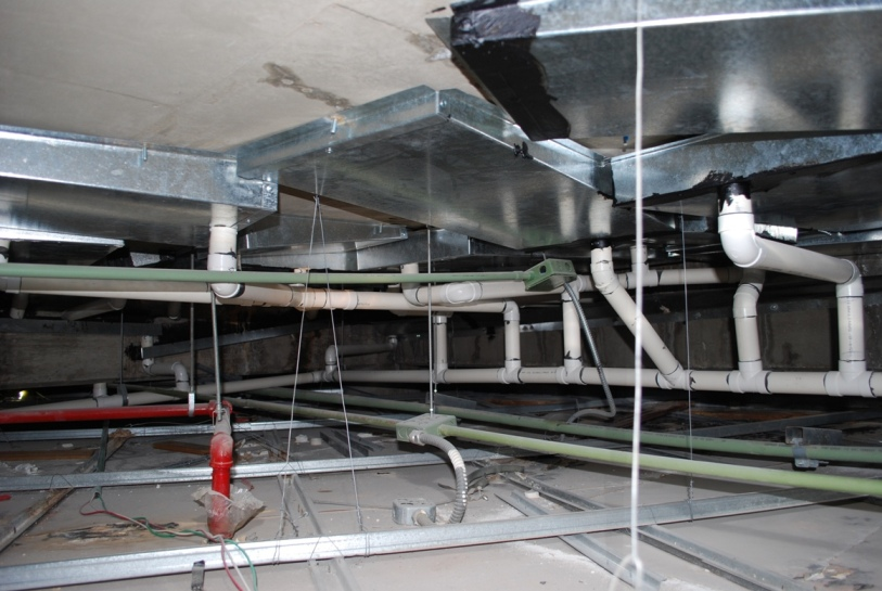 Figure 2: The extent and magnitude of the leaks were such that an elaborate system of gutters and drain piping had been installed below the slabs in an attempt to intercept and manage the leakage.