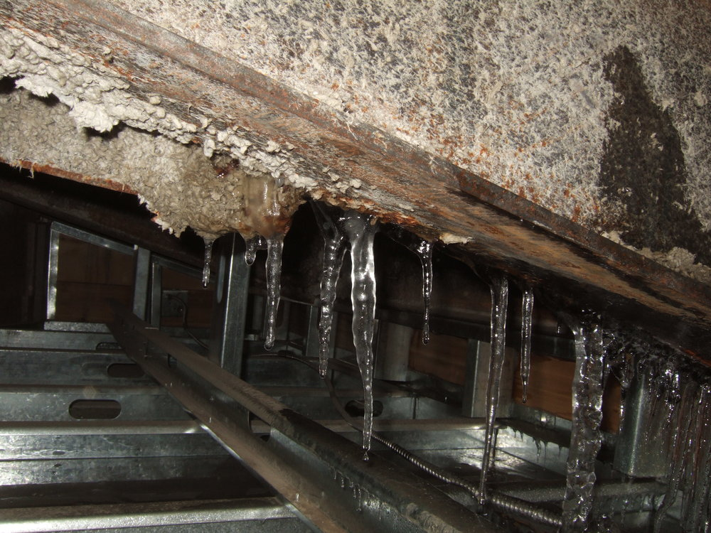 Figure 5:  Ice formation within a cold roof soffit due to exfiltration of warm, humid interior air