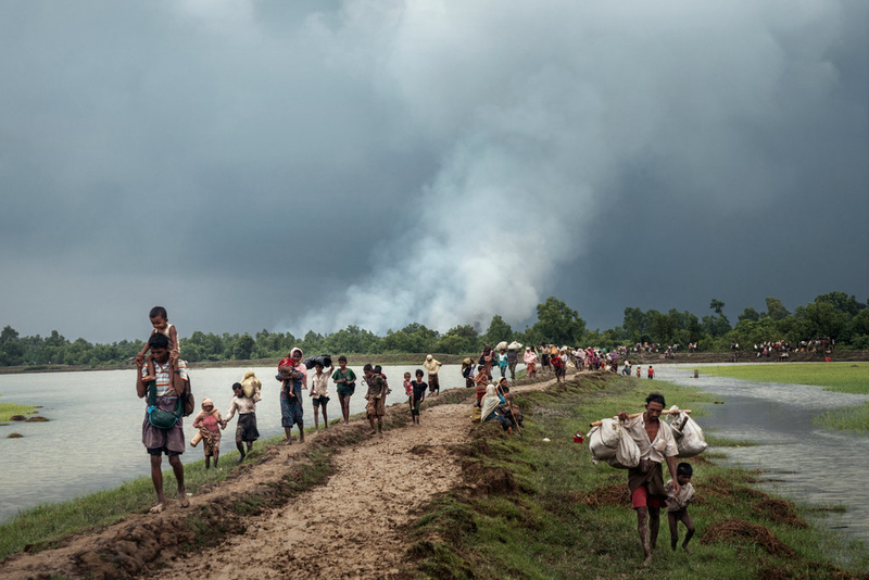 Rohingya refugees crossing the Naf river, along the border of Myanmar and Bangaladesh. (Adam Dean/The New York Times)