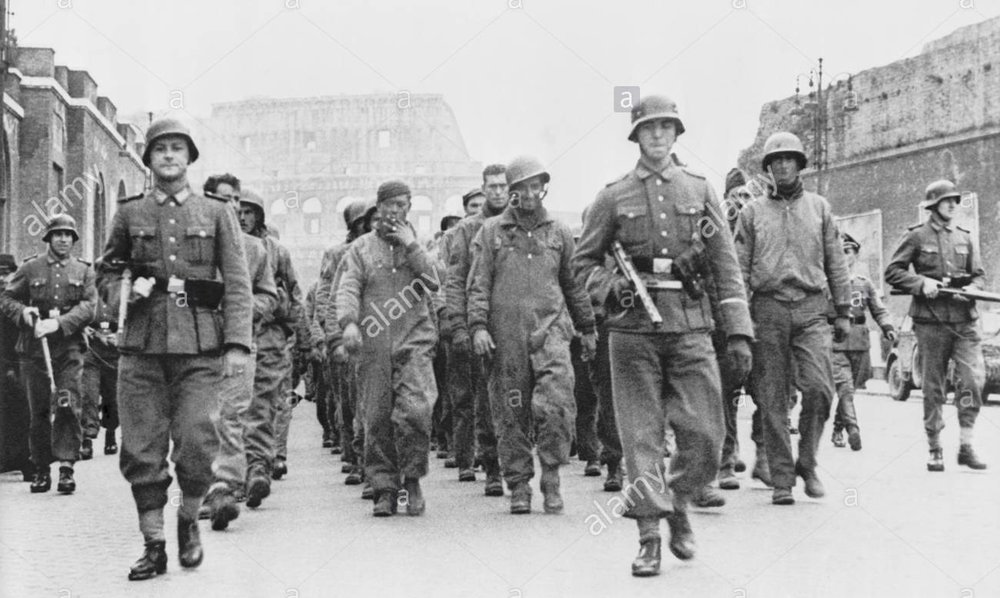 British and American prisoners of war marching through Rome under guard of German soldiers