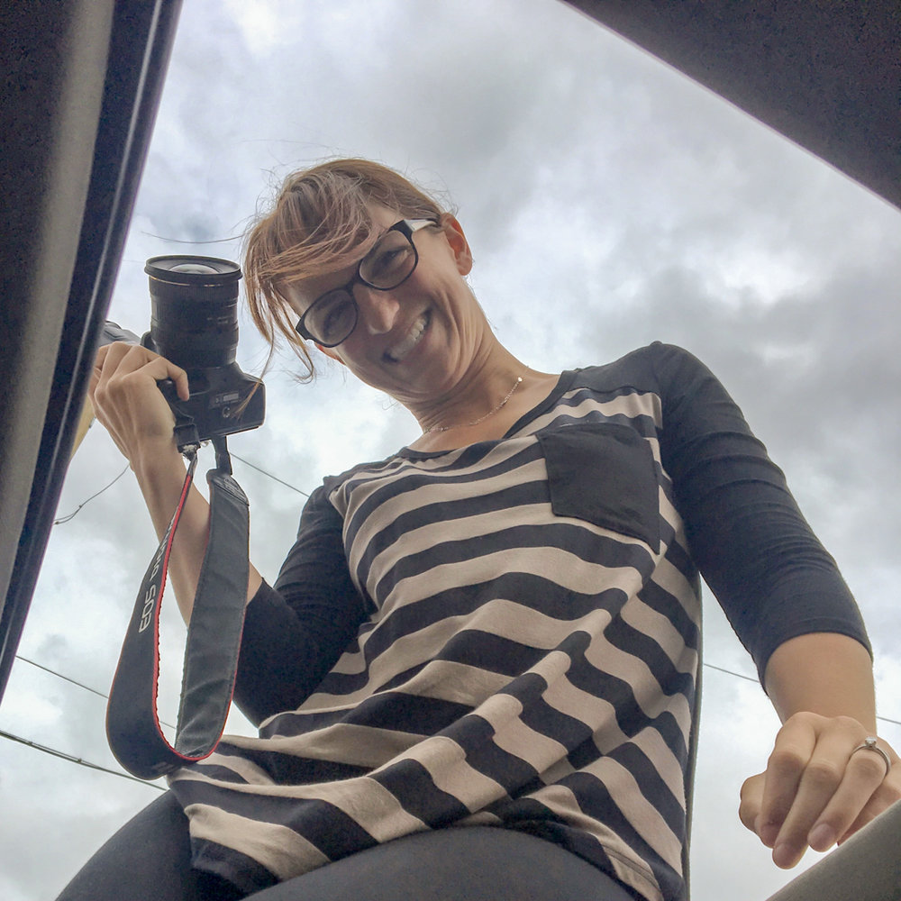 Katherine getting the shot through the moonroof of her car.