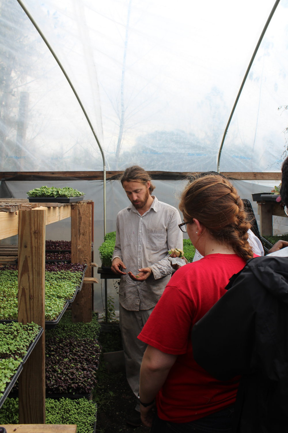 Chris with Vertu Farm talking with UGA students about microgreens and sustainable agriculture